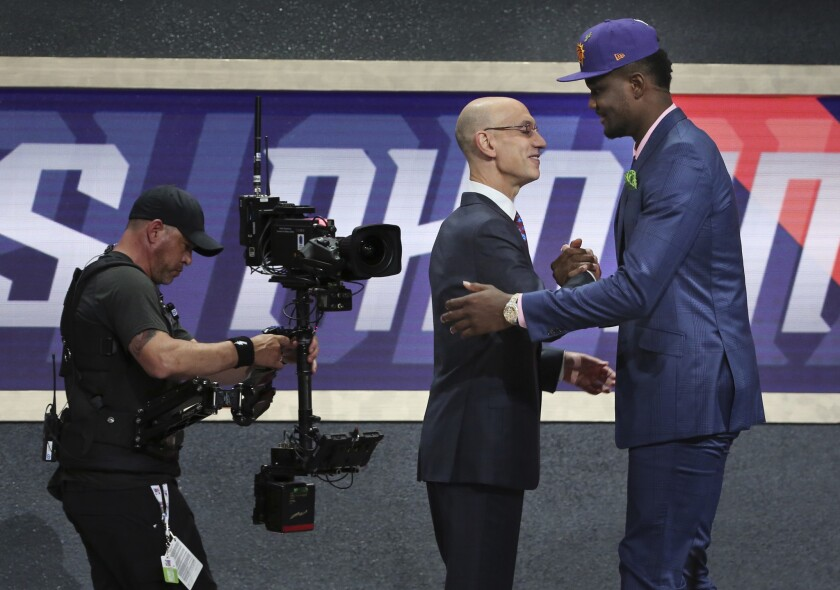 Deandre Ayton is greeted by Commissioner Adam Silver after he was picked first overall by the Phoenix Suns in the 2018 NBA draft.