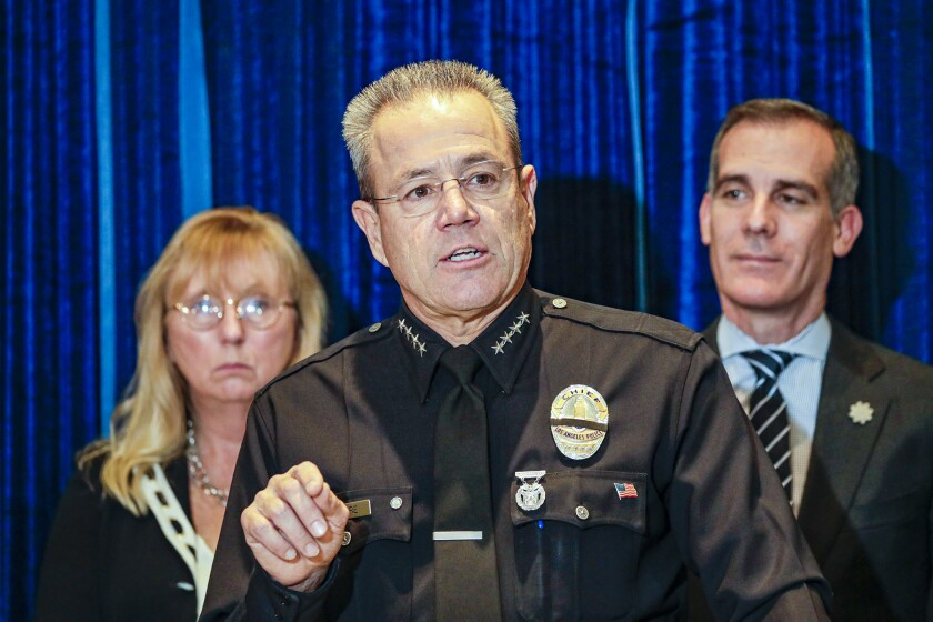 LAPD Chief Michel Moore speaks at a news conference flanked by Eileen Decker, president of the L.A. Police Commission, and Mayor Eric Garcetti.