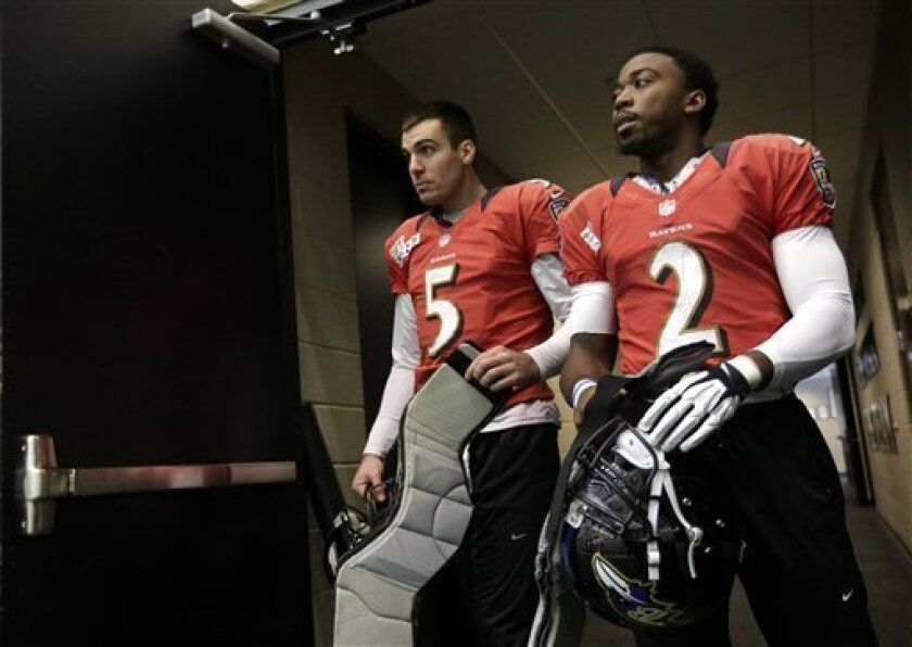 Baltimore Ravens quarterbacks Joe Flacco (5) and Tyrod Taylor walk out of a doorway for NFL football practice at the team's training facility in Owings Mills, Md., Friday, Jan. 25, 2013. The Ravens are scheduled to face the San Francisco 49ers in Super Bowl XLVII in New Orleans on Sunday, Feb. 3. (