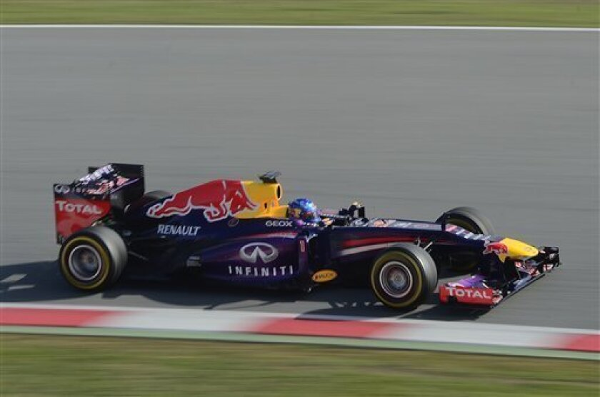 Sebastian Vettel of Germany and Infiniti Red Bull Racing drives drives his car during a test session at the Montmelo racetrack near of Barcelona, Spain, Sunday, March 3, 2013. (AP Photo/Manu Fernandez)