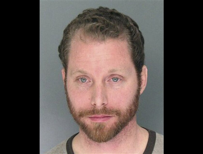 This undated photo provided by the Santa Cruz Police Department shows Jeremy Goulet. Goulet, 35, a recently fired coffee shop barista with a criminal history, opened fire on two Santa Cruz police detectives Tuesday, Feb. 26, 2013, when they came to his house to investigate a sexual assault complain
