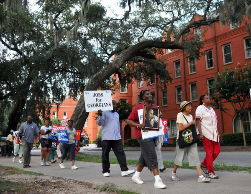 Marchers make their way around Forsyth Park in Savannah Ga. to commemorate the August 28, 1963 March on Washington for Jobs and freedom led by the Rev. Martin Luther King, Jr. The march was sponsored by Savannah Regional Central Labor Council AFL-CIO, St. Phillip Monumental A.M.E. Church, and Interdenominational Ministerial Alliance.