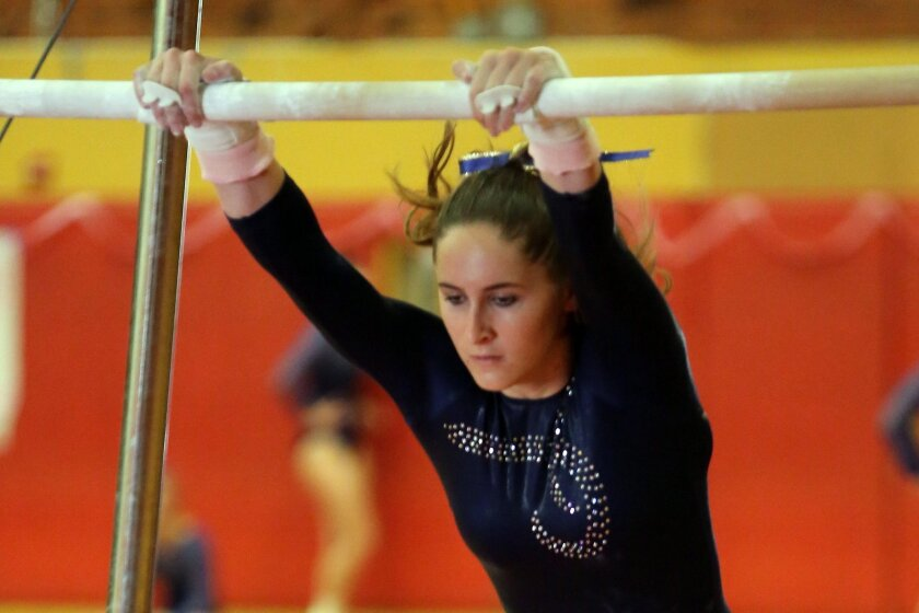 Del Norte senior Jiselle de Anda performs on the bars en route to winning a second straight optional all-around title at the Sundevil Invitational.