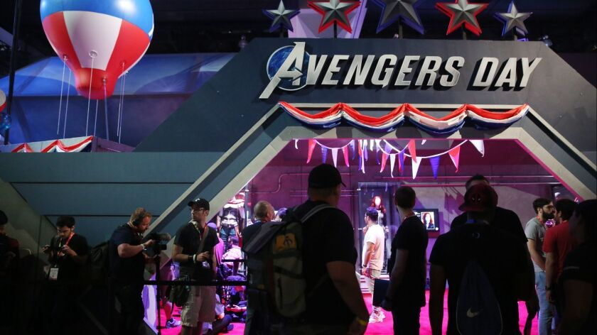 LOS ANGELES, CA-JUNE 12, 2019: People pass the Avengers booth during the annual Electronic Entertain