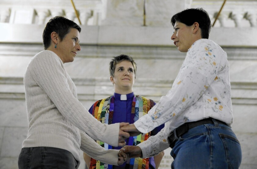 A couple marries in November in St. Louis. Some Missouri counties are issuing same-sex marriage licenses while the state's ban is being challenged.