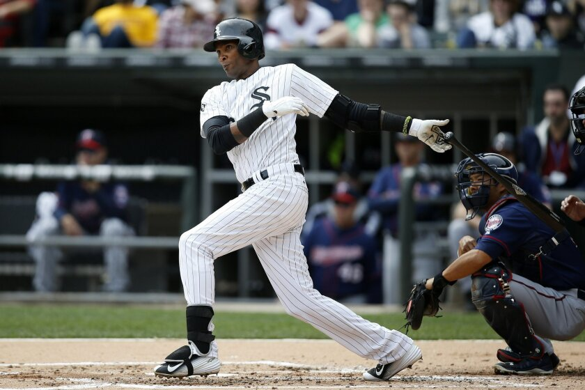 Chicago White Sox's Alexei Ramirez (10) hits an RBI-double against the Minnesota Twins during the first inning of a baseball game Sunday, April 12, 2015, in Chicago. (AP Photo/Andrew A. Nelles)