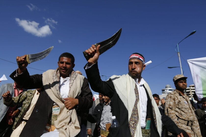 Houthis perform with traditional daggers during a demonstration against what they called U.S.-led interventions in domestic Yemeni affairs, in Sana, Yemen.