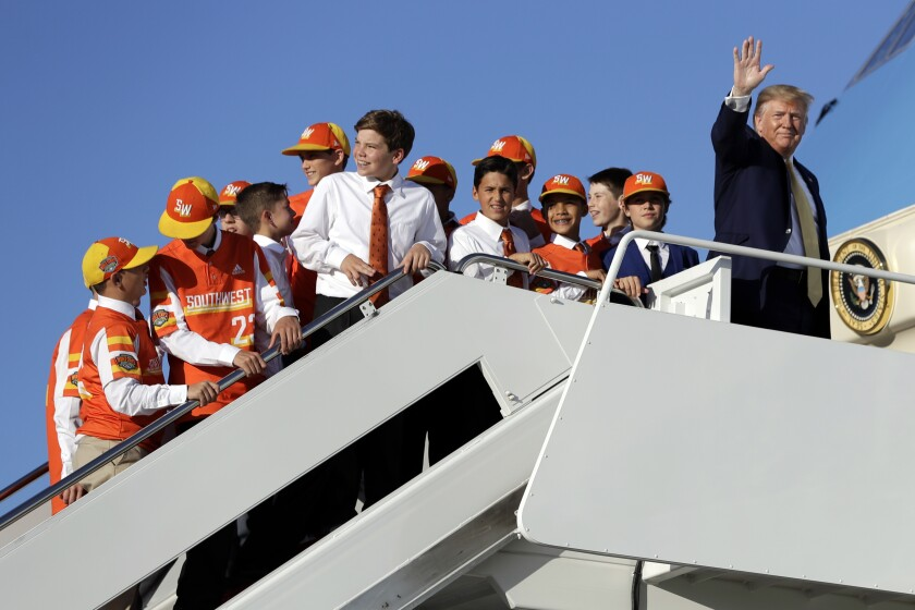 President Donald Trump boards Air Force One with Louisiana's Eastbank Little League team who won the 2019 Little League Baseball World Series Friday, Oct. 11, 2019, in Andrews Air Force Base, Md. Trump was heading to a campaign rally in Lake Charles, La. (AP Photo/Evan Vucci)