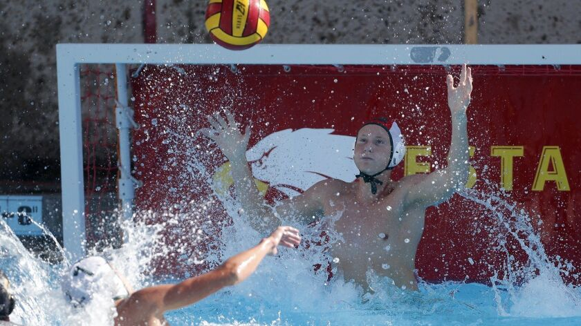 Costa Mesa High goalkeeper Joey Palmdale defends against Estancia during the first half in an Orange