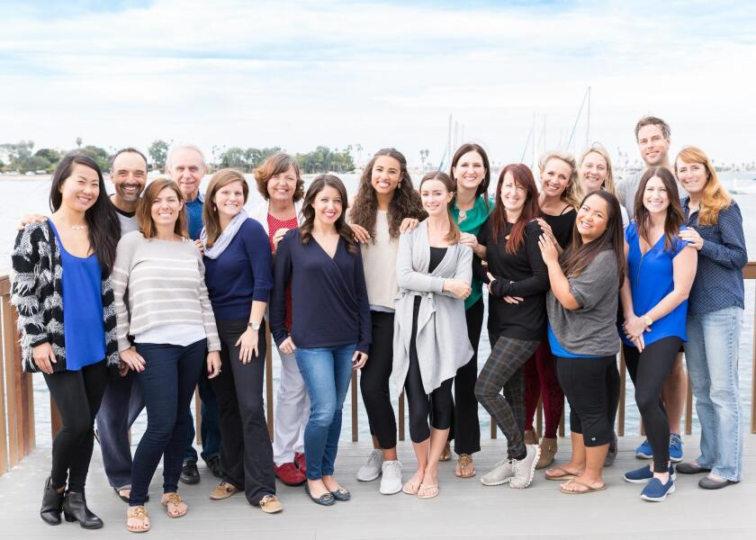 The True Life team poses for a photo during their annual staff retreat.