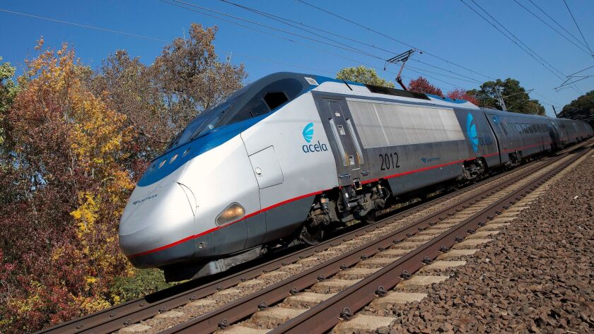 An Amtrak Acela train travels through Old Lyme, Conn. on Oct. 18. Last year the Federal Railroad Administration granted a Buy American Act waiver to Amtrak so it could buy 28 multi-car trains from France-based Alstom.