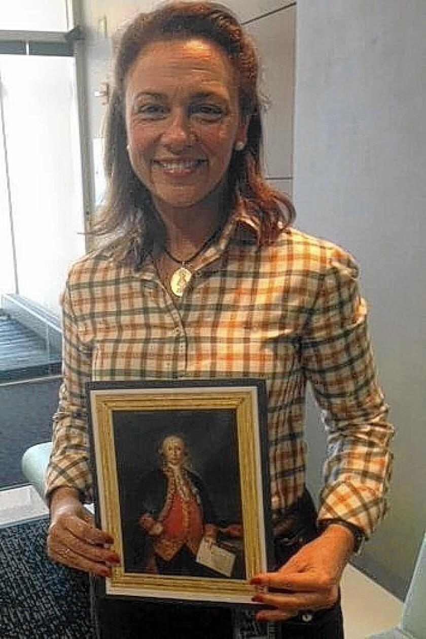 Teresa Valcarce with a portrait of Bernardo de Galvez.