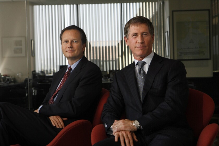 Lionsgate vice chairman Michael Burns, left, and CEO Jon Feltheimer at the company's Santa Monica offices on April 3, 2010.