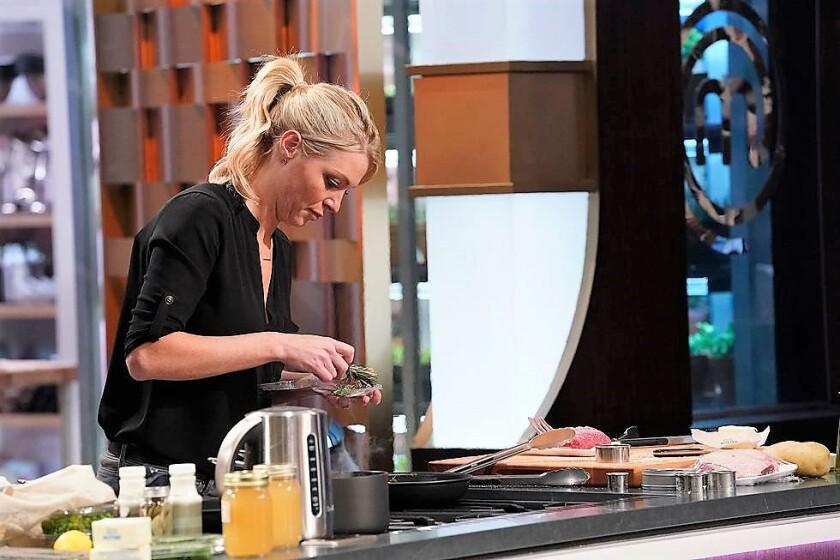 Sarah Faherty prepares herb-crusted lamb lollipops on MasterChef Season 10 (2).jpg