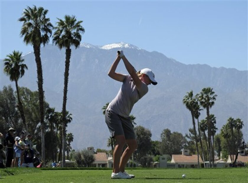 Stacy Lewis hits her tee shot on the fifth hole during the final round of the LPGA Kraft Nabisco Championship golf tournament in Rancho Mirage, Calif., Sunday, April 3, 2011. (AP Photo/Chris Carlson)