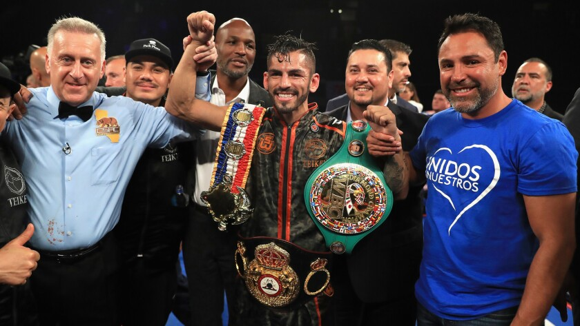 Jorge Linares celebrates after defeating Luke Campbell to retain his WBA lightweight title.