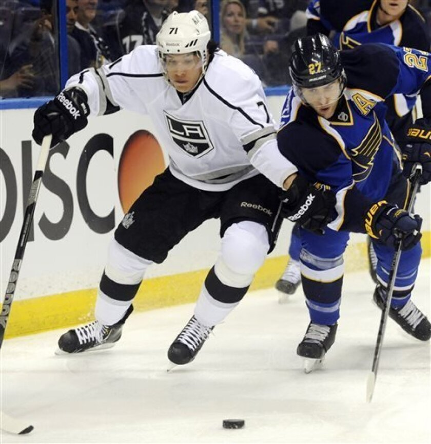 St. Louis Blues' Alex Pietrangelo (27) and Los Angeles Kings' Jordan Nolan (71) reach for a loose puck during the first period of Game 1 of their first-round NHL hockey Stanley Cup playoff series, Tuesday, April 30, 2013, in St. Louis. (AP Photo/Bill Boyce)