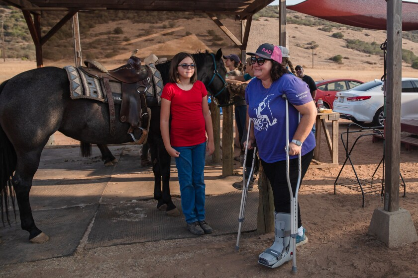 Haley Contreras and Allie Sarnataro at the Ride Above Disability Therapeutic Riding Center in Poway.