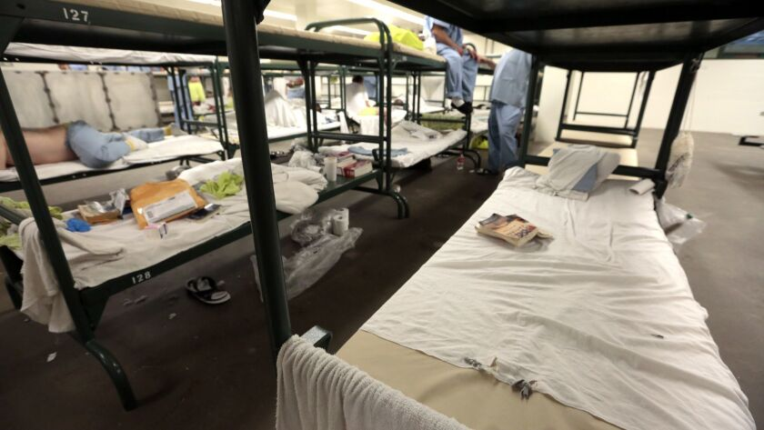 Men's Central Jail in Los Angeles with bunks lined up, end to end, on April 15, 2015.