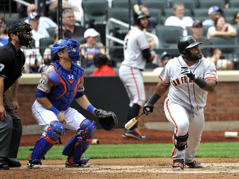 New York Mets catcher Travis d'Arnaud and San Francisco Giants third baseman Pablo Sandoval watch Sandoval's two-run double off of Mets starting pitcher Dillon Gee in the third inning of a baseball game at Citi Field on Monday, Aug. 4, 2014, in New York. (AP Photo/Kathy Kmonicek)