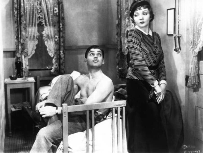 """Clark Gable and Claudette Colbert in 'It Happened One Night."""" Gable was credited with a slump in undershirt sales after he appeared bare-chested."""