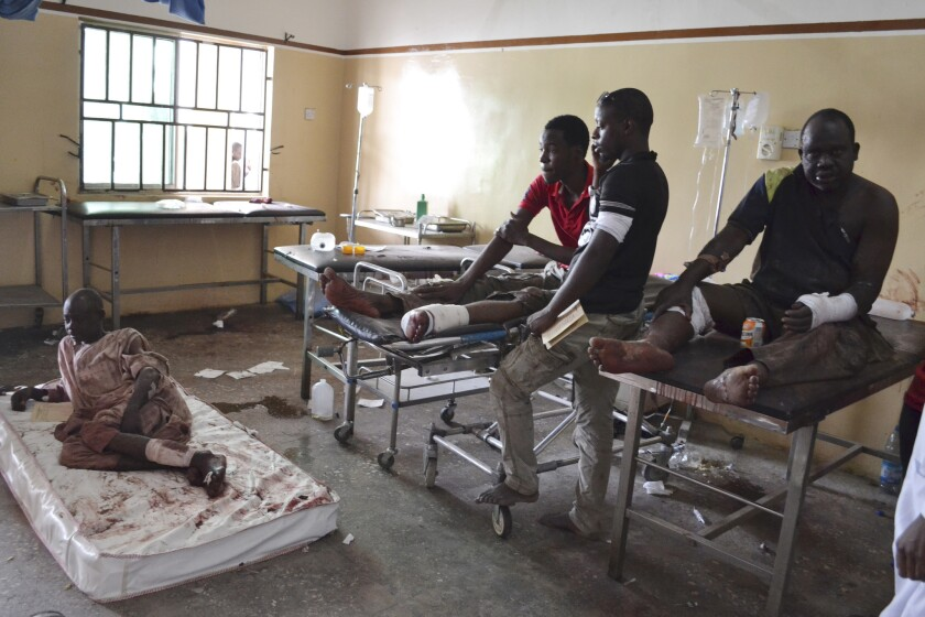 Nigeria's public hospitals are crowded and decrepit. Here, victims of a bomb attack in Maiduguri in 2015 await treatment in a public hospital.