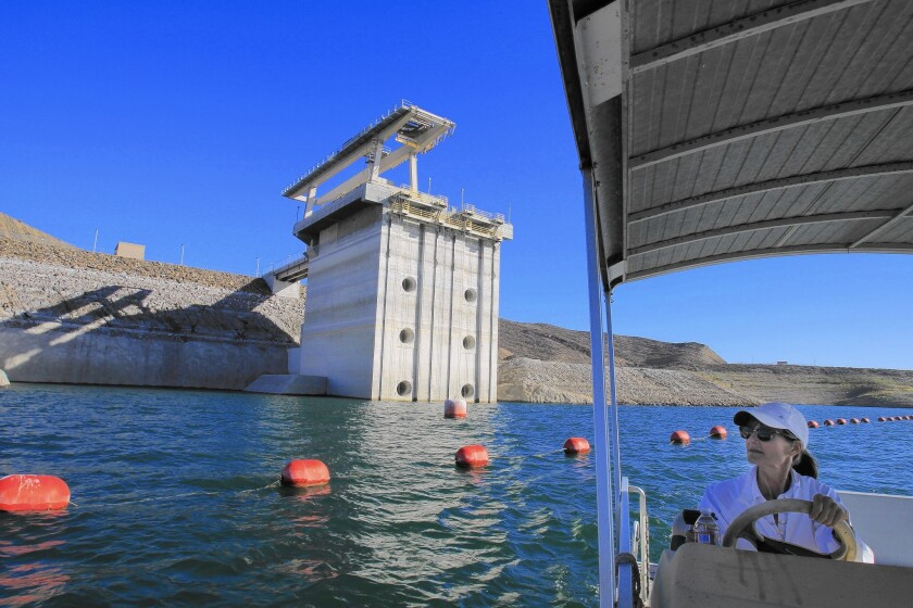 Sheri Shaffer, a manager with the Metropolitan Water District of Southern California, views the water inlet/outlet tower's exposure, revealing how far the water has receded at the Diamond Valley Lake in Hemet.