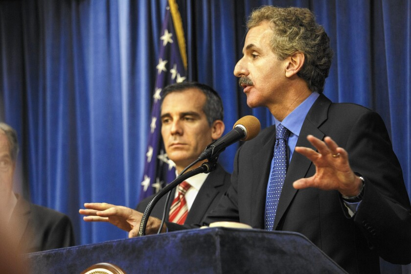 "L.A. City Atty. Mike Feuer has ""walled himself off"" from his office's deliberations over a DWP lawsuit seeking to prevent the release of names and addresses of those who received turf rebates from the MWD. Feuer received a rebate."