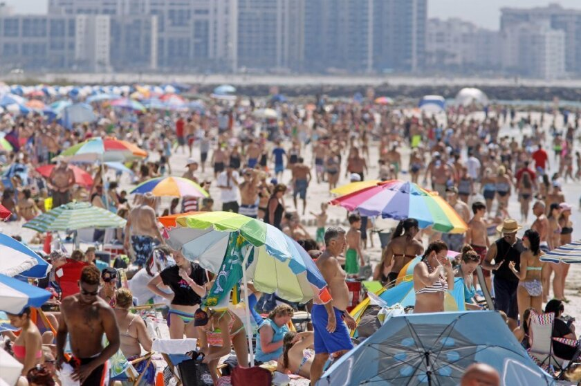 Sales of vacation homes are surging, especially in the South. Above, a scene in Clearwater Beach, Fla.