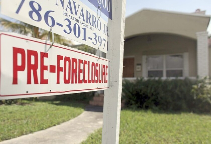 A home with a pre-foreclosure sale sign