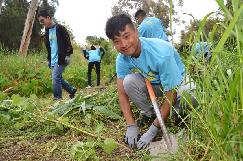 Volunteers participate in I Love a Clean San Diego's Creek to Bay Cleanup last spring at Cooper Canyon in City Heights.