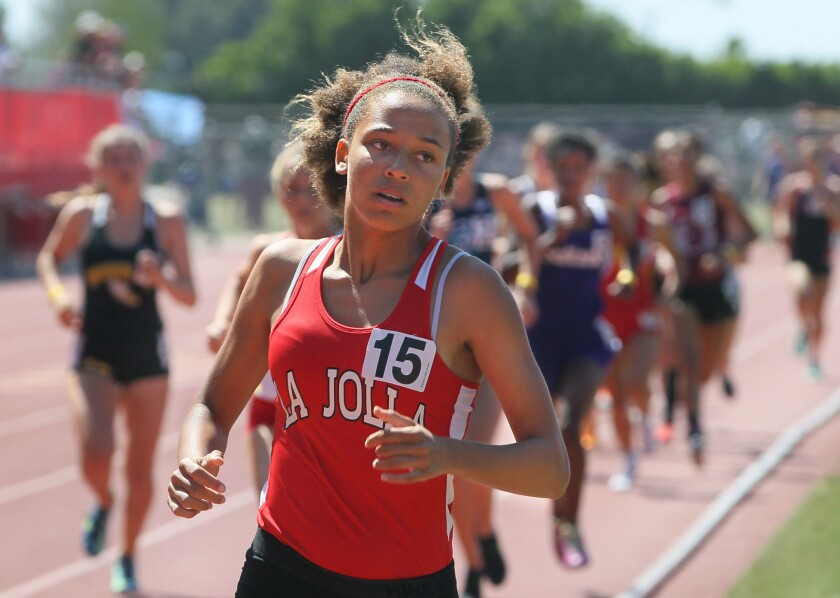 Freshman Sierra Roberson, of La Jolla High, leads at the first lap of Race 1 of the Girls 800 meter, She went on to win with an excellent time of 2:14.54.