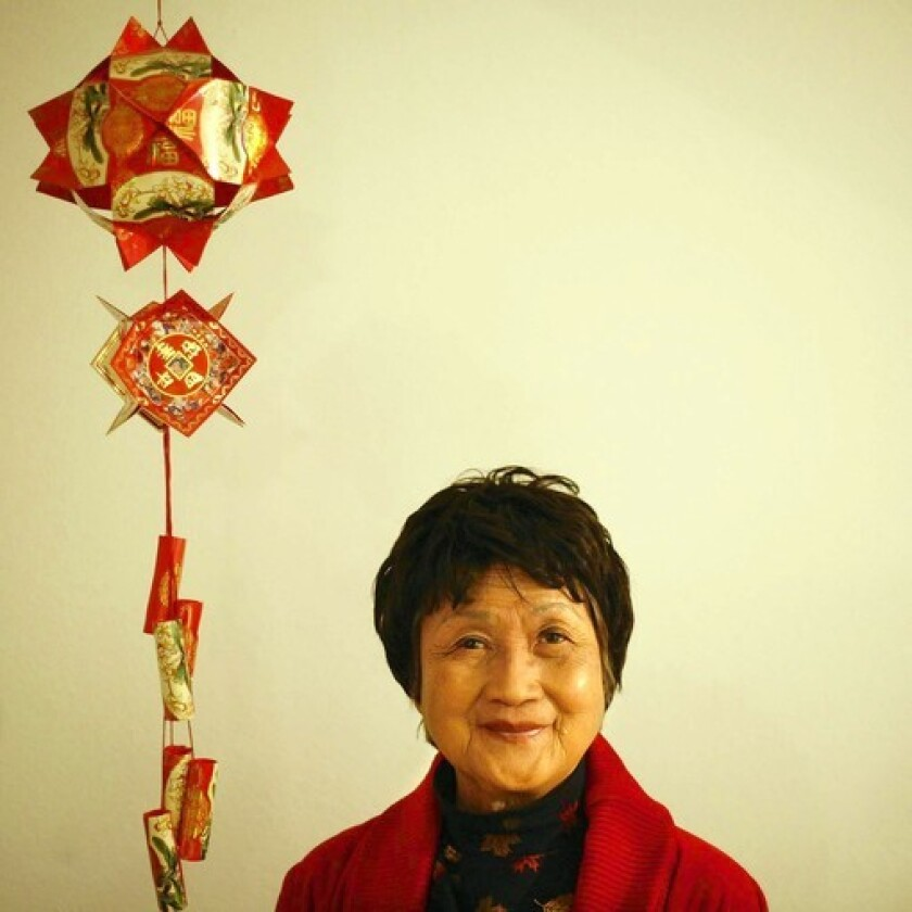 Tina Wong influences her granddaughter's Christmas dinners with traditional Chinese dishes served alongside traditional American cuisine.