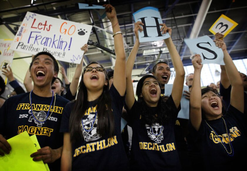 Franklin students Elijah Trinidad, left, Sabrina Velasco, Sandra Ruiz and Grace Punzalan cheer on their Academic Decathlon team during the Super Quiz at the regional decathlon competition in Los Angeles in February.