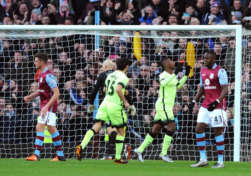 Manchester City's Kelechi Iheanacho, 2nd right, celebrates after scoring a penalty against Aston Villa during the English FA Cup fourth round soccer match between Aston Villa and Manchester City at Villa Park in Birmingham, England, Saturday, Jan. 30, 2016. (AP Photo/Rui Vieira)