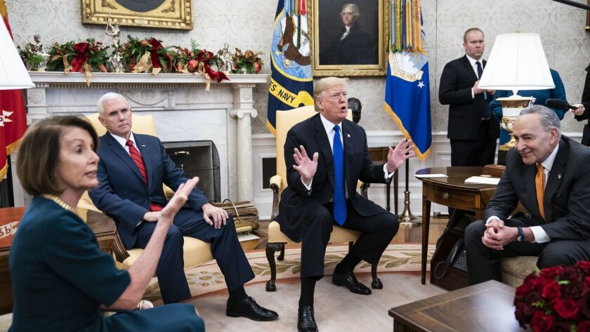 President Trump debates with House Minority Leader Nancy Pelosi and Senate Minority Leader Charles E. Schumer, right, as Vice President Mike Pence listens during a meeting in the Oval Office on Dec. 11.