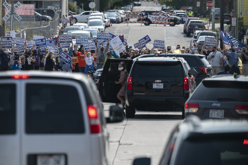 Supporters Joe Biden cheer as his motorcade arrives at Wisconsin Aluminum Foundry in Manitowoc, Wis., Monday, Sept. 21.