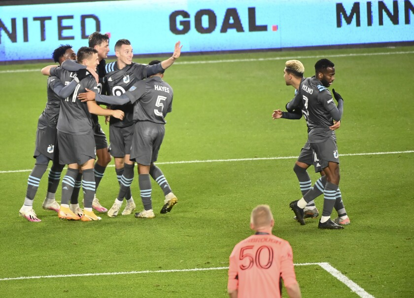 Minnesota United players celebrate a goal by midfielder Robin Lod, second from left, late in the first half against the Colorado Rapids in an MLS soccer match Wednesday, Oct. 28, 2020, in St. Paul, Minn. (Aaron Lavinsky/Star Tribune via AP)