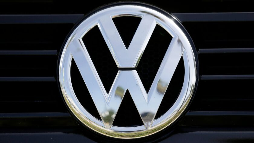 FILE - This Sept. 21, 2015, file photo, shows the Volkswagen logo on a car for sale at New Century V