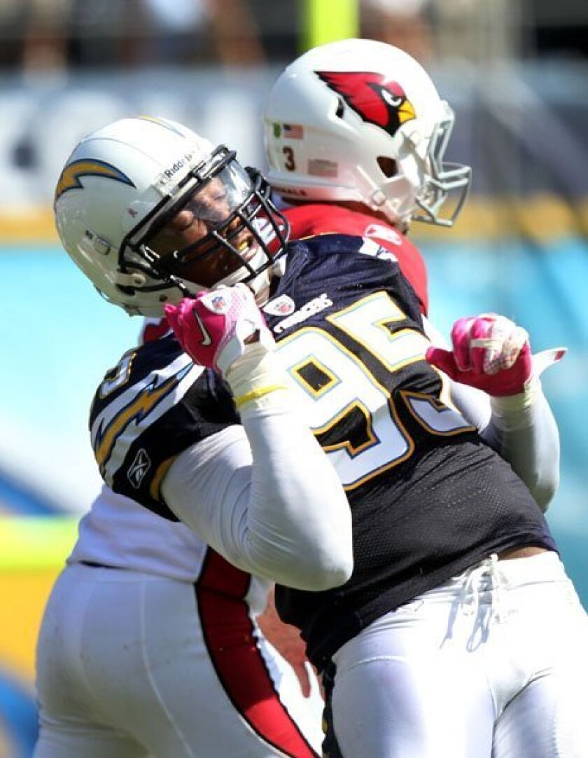 Shaun Phillips celebrates after sacking Derek Anderson in the second quarter last Sunday. His six sacks are second-most in the NFL this season.