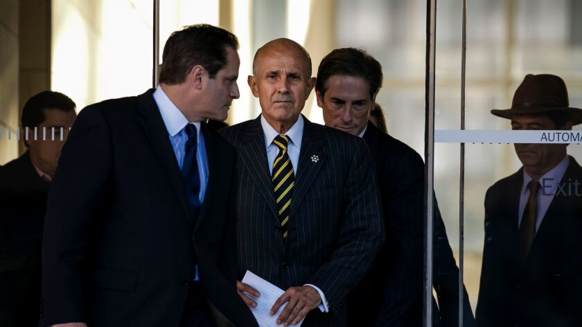 Former Los Angeles County Sheriff Lee Baca leaves federal court Dec. 22 after his mistrial on obstruction charges. His retrial is scheduled to begin next week.