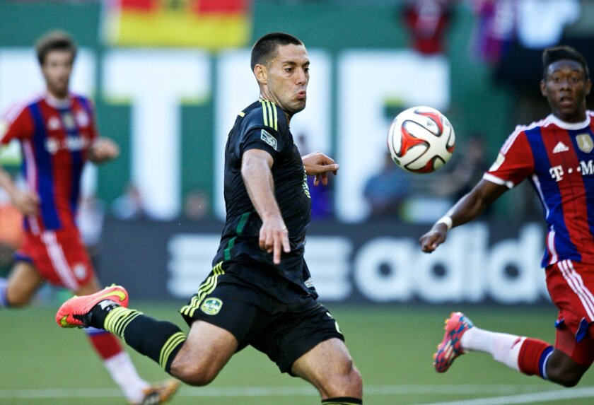 MLS All Stars' Clint Dempsey, of the Seattle Sounders, takes a shot against Bayern Munich during the MLS All-Star soccer game, Wednesday, Aug. 6, 2014, in Portland, Ore. (AP Photo/The Oregonian, Thomas Boyd)