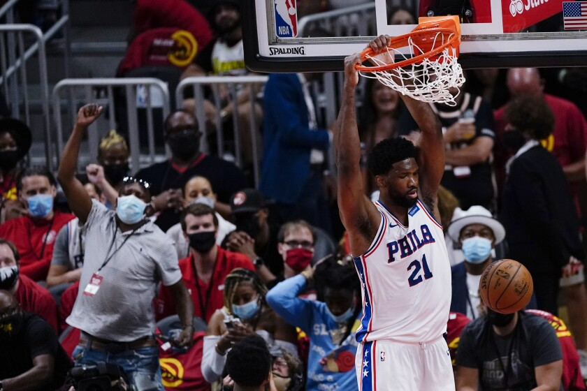 76ers center Joel Embiid dunks during the second half of Philadelphia's victory at Atlanta on June 11, 2021.