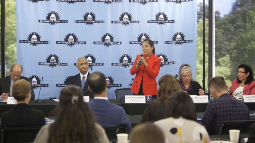 Democrat Eleni Kounalakis, standing, speaks during a lieutenant governor's race debate April 17. Also there are candidates Jeff Bleich, left, Ed Hernandez, Gayle McLaughlin and Lydia Ortega.