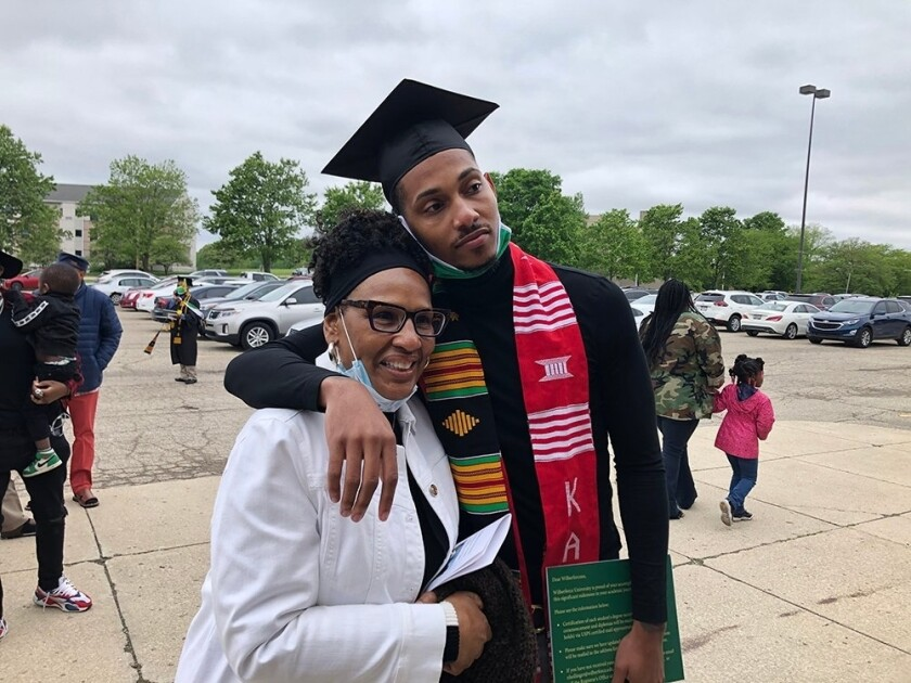 This photo provided by Wilberforce University, graduate Rodman Allen hugs his mother after the commencement ceremony at Wilberforce University, Saturday, May 29, 2021, in Wilberforce, Ohio. (Wilberforce University via AP)