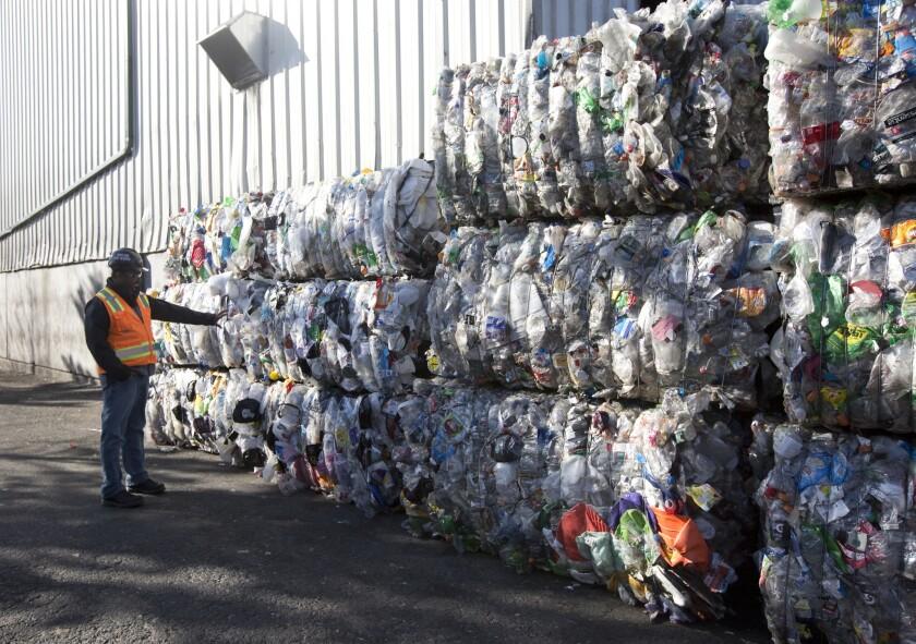 Compressed blocks of plastic trash