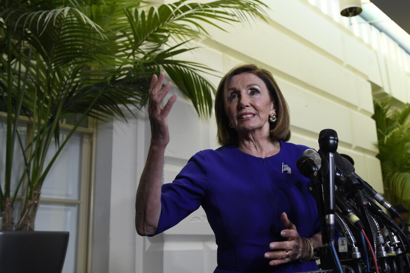 House Speaker Nancy Pelosi of Calif., stops to talks with reporters following a meeting with her caucus on Capitol Hill in Washington, Tuesday, Sept. 24, 2019. (AP Photo/Susan Walsh)