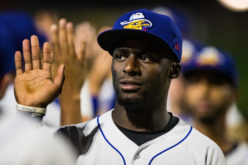 Padres prospect Taylor Trammell greets teammates after the game against the Midland RockHounds at HODGETOWN Stadium in Amarillo, Texas.