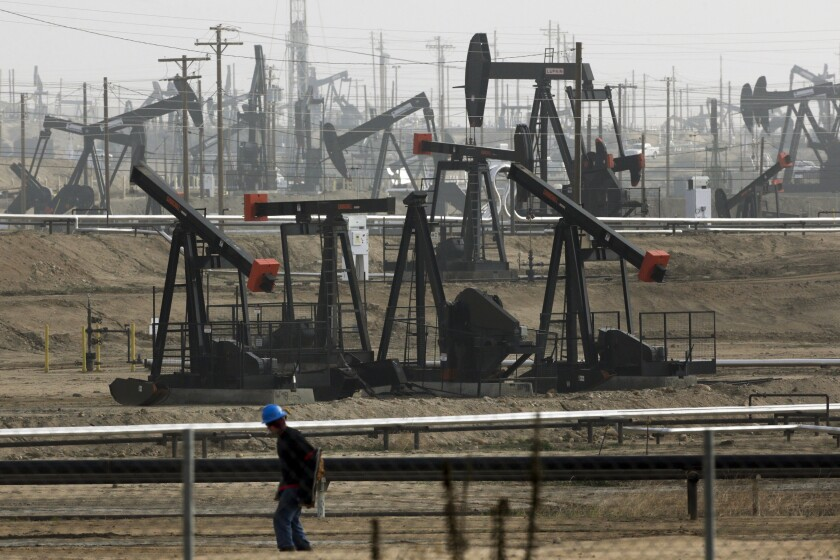FILE - This Jan. 16, 2015, file photo shows pumpjacks operating at the Kern River Oil Field in Bakersfield, Calif., which is overseen by the U.S. Bureau of Land Management. Oil production from federally-managed lands and waters topped a record 1 billion barrels in 2019, according to the Department of Interior on Tuesday, Feb. 11, 2020. (AP Photo/Jae C. Hong, File)