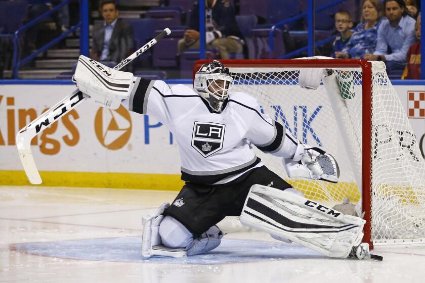 Kings goalie Jhonas Enroth makes a save against St. Louis onNov. 3.